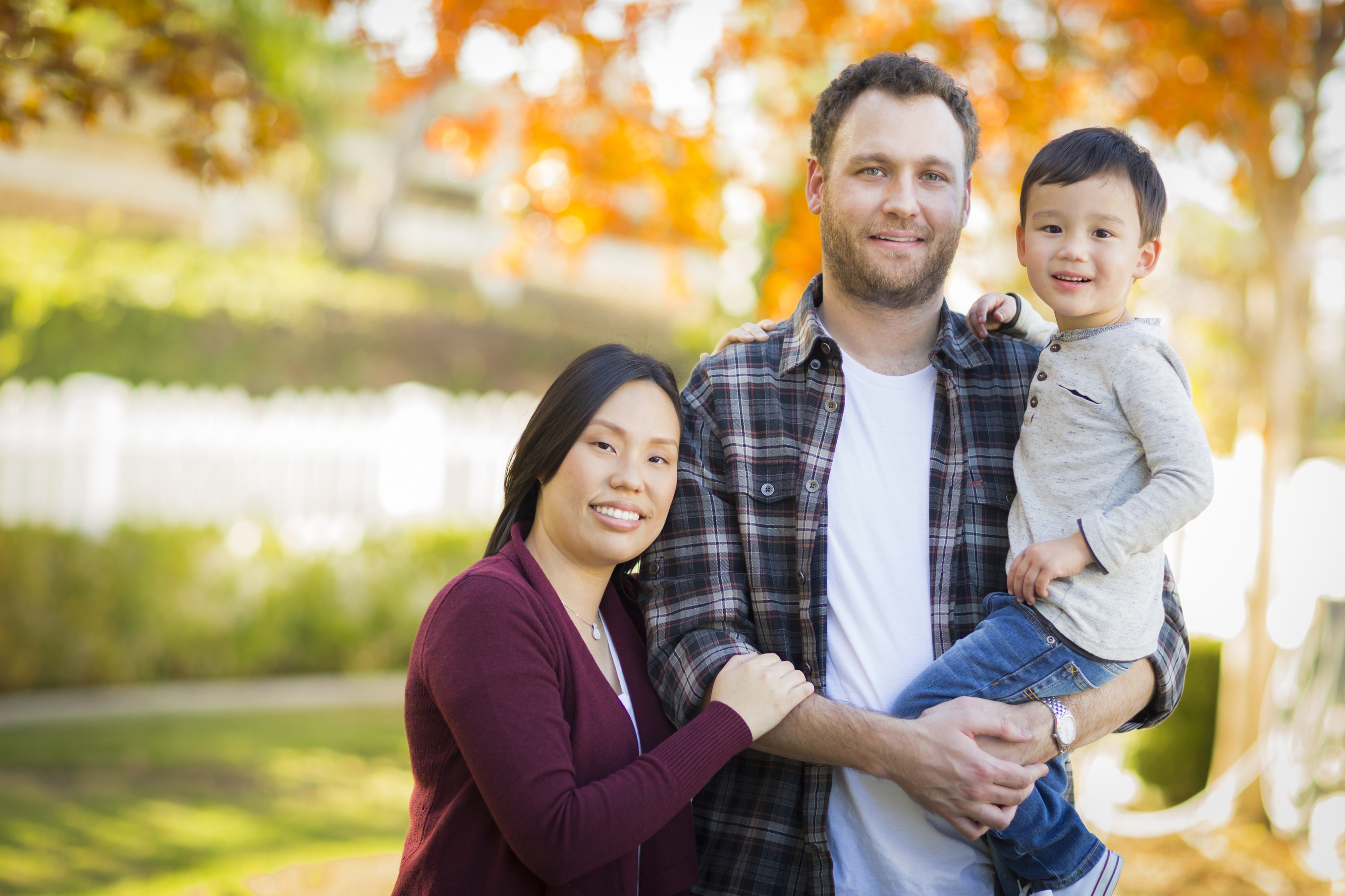 Mixed Race Young Family Portrait Outdoors